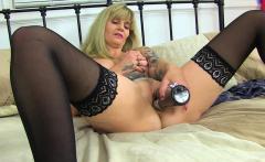 British and tattooed milf Kat puts her sex toy to work