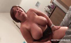 Mature busty babe masturbates in hot solo scene