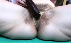 Hairy mature loves toying her tight