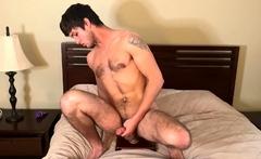 Horny stud films himself riding a huge dildo hardcore