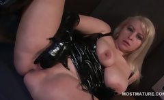 Mature tramp in latex riding dildo and finger fucking cunt