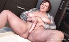 Redhead mature masturbating with dildo at home