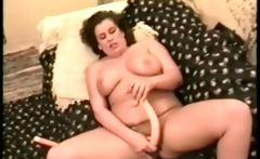 Nasty brunette MILF big boobed whore